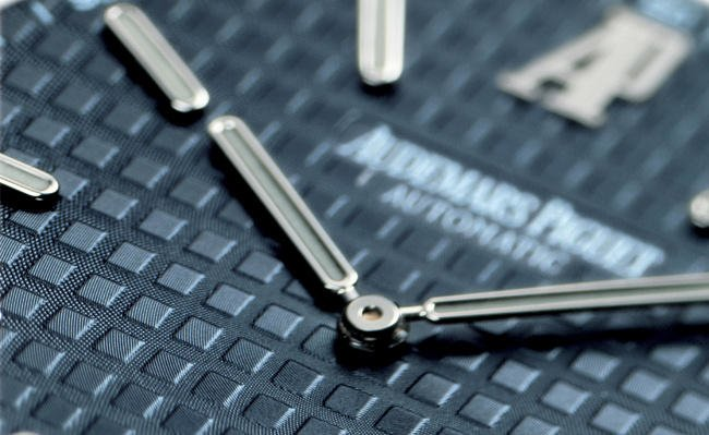 The signature Audemars Piguet Tapisserie pattern on the face of the watch