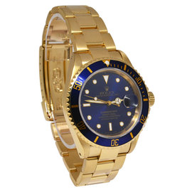 Rolex Submariner 16618 18K Yellow Gold 40mm Watch