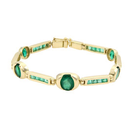 Magnificent Estate 18kt Yellow Gold 10.50ctw Oval & Baguette Emerald Bracelet