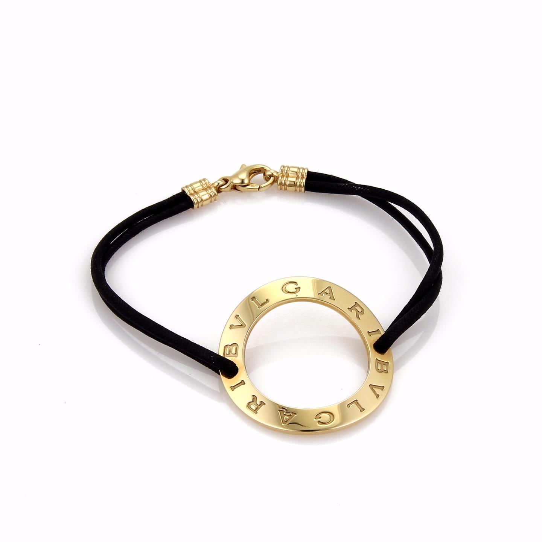 "Image of ""Bulgari Bvlgari 18K Yellow Gold Circle Charm Double Cord Bracelet"""