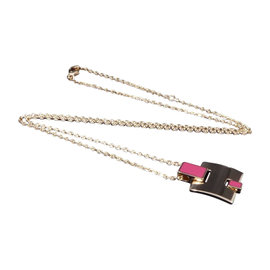 Hermes Pink Gold Tone and Lacquer Pendant Necklace Features