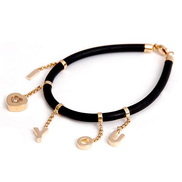 "Image of ""Chopard Happy Diamond 'I Love You' 18k Yellow Gold Rubber Bracelet"""