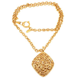 Chanel Gold Tone Long Textured Amulet Logo Necklace
