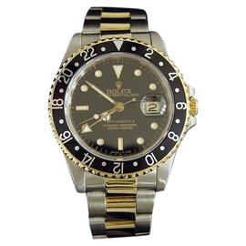 Rolex GMT-Master II 16713 2Tone 18K Yellow Gold and Stainless Steel Oyster Black Mens Watch