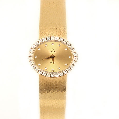 "Image of ""Concord 14K Yellow Gold with Champagne Dial 21mm Womens Watch"""