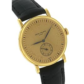 Patek Philippe Calatrava 5022J 18K Yellow Gold Champagne 33mm Mens Watch