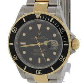 Rolex Submariner 16613 Steel 18K Gold Two Tone Black Date Diver Watch