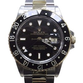 Rolex GMT Master 16753 18K Yellow Gold & Stainless Steel Black Dial Automatic 40mm Mens Watch
