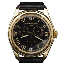 Patek Philippe 5035J Annual Calendar Yellow Gold Black Dial 37mm Unisex Watch