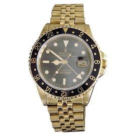 Rolex GMT-Master 16758 Solid 18K Yellow Gold Date Jubilee w/Black Dial & Bezel Mens Watch