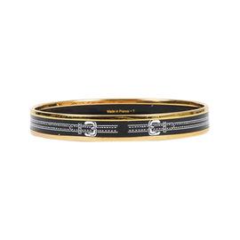 Hermes Gold Tone Hardware and Palladium with Black and White Enamel