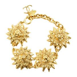 Chanel 'CC' Charm Gold Tone Metal Lion Head Sunburst Link Bracelet