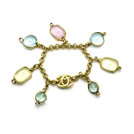 Chanel Gold Tone Interlocking Poured Glass Bracelet
