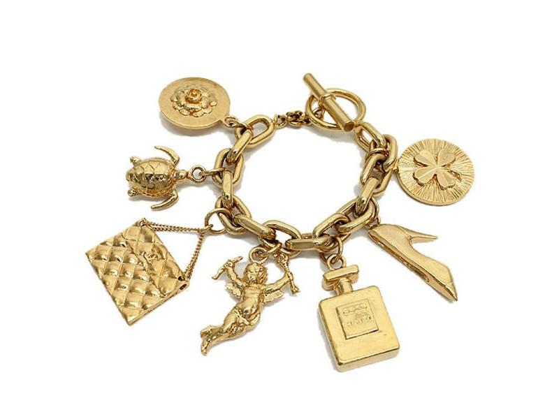 Chanel Gold Tone Metal Matelasse Perfume Angel Charm Bracelet