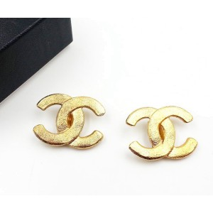 Chanel Gold Tone Metal Sand Texture Clip on Earrings