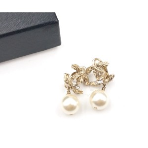 Chanel CC Gold Tone Metal Pearl Dangle Clip on Earrings
