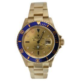 Rolex Submariner 16618 18K Yellow Gold Rolex Original Champagne Serti Diamond and Sapphire Dial Watch