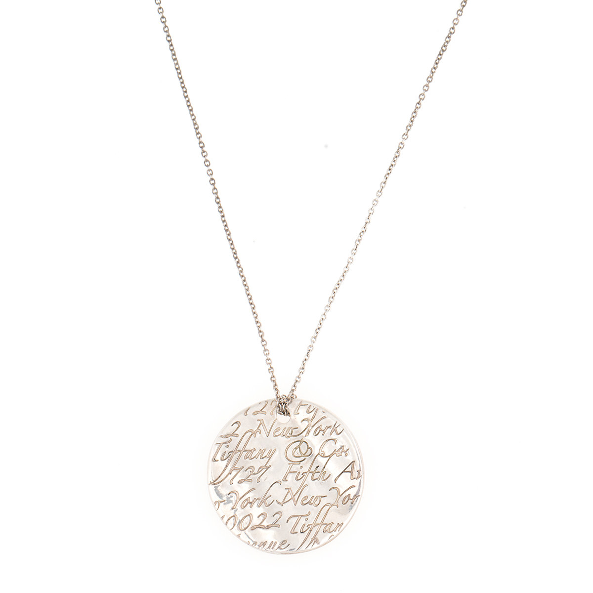 "Image of ""Tiffany & Co. Notes 5th Ave New York Disc Sterling Silver Pendant"""